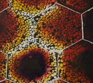 Abstrakt textiltryck med hexagonmönster.