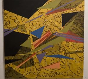 Abstrakt collage med olikfärgade trianglar mot gul bakgrund.