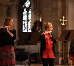Tre flöjtspelare i Nicolaikyrkan